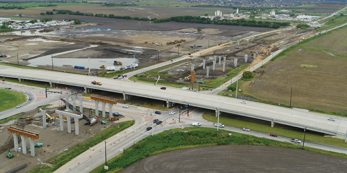 Close-up view of widened US 380 and progressing over-path construction for Dallas North Tollway Phase 4A project.